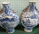 A near pair of Chinese moon flasks